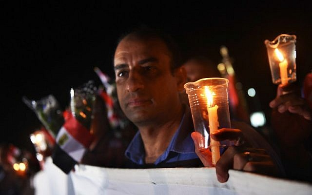 People light candles during a ceremony to mark the first anniversary of the Russian MetroJet plane crash on October 30, 2016 in the Egyptian Red Sea resort of Sharm el-Sheikh. (AFP/ MOHAMED EL-SHAHED)