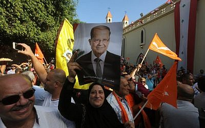 Supporters of Lebanon's Free Patriotic Movement celebrate the election of their leader Michel Aoun in the town of Jdeideh, north of Beirut, on October 31, 2016. (AFP PHOTO/MARWAN TAHTAH)