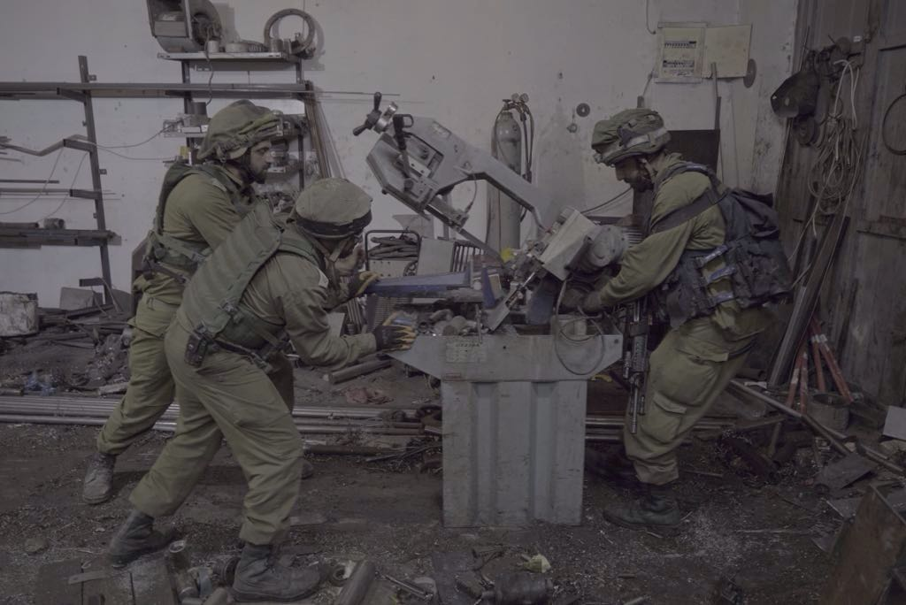 IDF soldiers confiscate machinery from an alleged gunsmithing workshop in the Palestinian village of Azzun, in the northern West Bank, on October 10, 2016. (IDF Spokesperson's Unit)