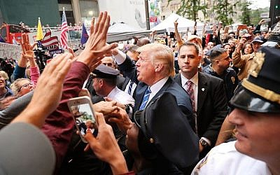 Donald Trump greets supporters outside of Trump Towers in Manhattan October 8, 2016, in New York City. (Spencer Platt/Getty Images/AFP)