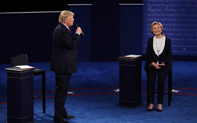 Republican presidential nominee Donald Trump, left, speaks as Democratic presidential nominee  Hillary Clinton looks on during the town hall debate at Washington University on October 9, 2016 in St Louis, Missouri. (Win McNamee/Getty Images/AFP)