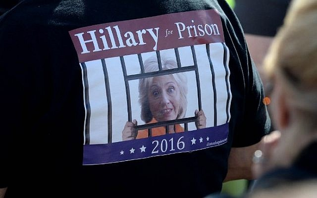 A Donald Trump supporter wears a Hillary for Prison t-shirt during a rally at Toyota Of Portsmouth on October 15, 2016 in Portsmouth, New Hampshire. (Darren McCollester/Getty Images/AFP)