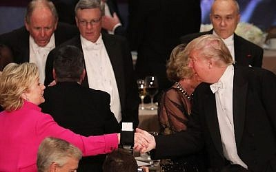 Hillary Clinton shakes hands with Donald Trump while attending the annual Alfred E. Smith Memorial Foundation Dinner at the Waldorf Astoria on October 20, 2016 in New York City. (Spencer Platt/Getty Images/AFP)
