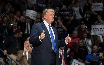 Republican presidential nominee Donald Trump greets supporters at a campaign stop at the Cambria County War Memorial Arena on October 21, 2016 in Johnstown, Pennsylvania. (Justin Merriman/Getty Images/AFP)
