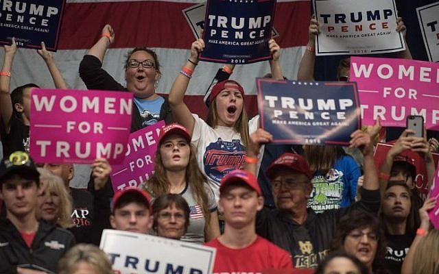 Supporters of Republican presidential nominee Donald Trump cheer during his campaign stop at the Cambria County War Memorial Arena on October 21, 2016 in Johnstown, Pennsylvania. (Justin Merriman/Getty Images/AFP)