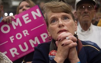 A supporter of Republican presidential candidate Donald Trump listens on as he speaks during a campaign stop at the Cambria County War Memorial Arena on October 21, 2016 in Johnstown, Pennsylvania. (Justin Merriman/Getty Images/AFP)