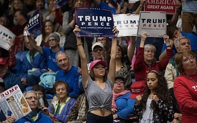 Supporters of Republican presidential nominee Donald Trump hold up their signs as he speaks during a campaign stop at the Cambria County War Memorial Arena on October 21, 2016 in Johnstown, Pennsylvania. (Justin Merriman/Getty Images/AFP)