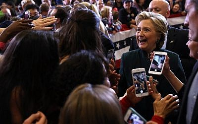 Democratic presidential nominee former Secretary of State Hillary Clinton greets supporters during a campaign rally at Cuyahoga Community College on October 21, 2016 in Cleveland, Ohio.  (Justin Sullivan/Getty Images/AFP)