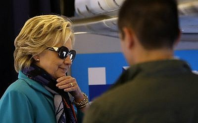 Democratic presidential nominee and former secretary of state Hillary Clinton talks with members of her staff aboard her campaign plane at Westchester County Airport in White Plains, New York on October 29, 2016.  (Justin Sullivan/Getty Images/AFP)