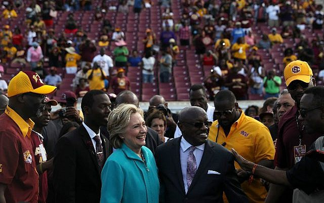 Democratic presidential nominee Hillary Clinton greets attendees during a tailgate homecoming party at Bethune-Cookman University on October 29, 2016 in Daytona Beach, Florida. (Justin Sullivan/Getty Images/AFP)