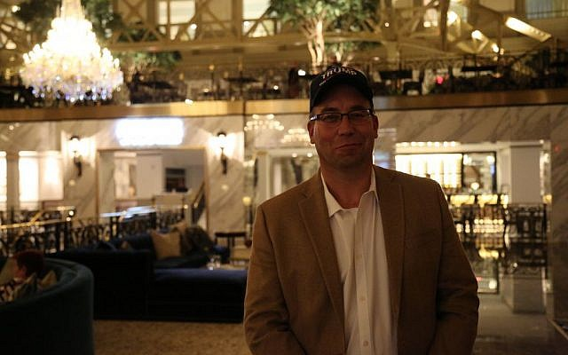 Trump supporter and radio host Scott Binsack poses for a photo in Trump International Hotel in Washington, D.C. (Eric Cortellessa/Times of Israel)