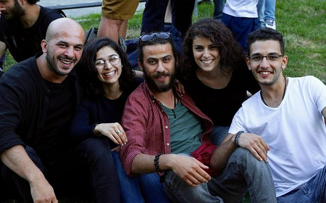 An IsraAID staff member (second from right) with Middle Eastern refugees in Berlin, summer 2016. (Hillel Zand)
