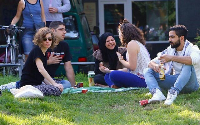 IsraAID volunteers and Middle Eastern refugees at a picnic in Berlin, summer 2016 (Hillel Zand)