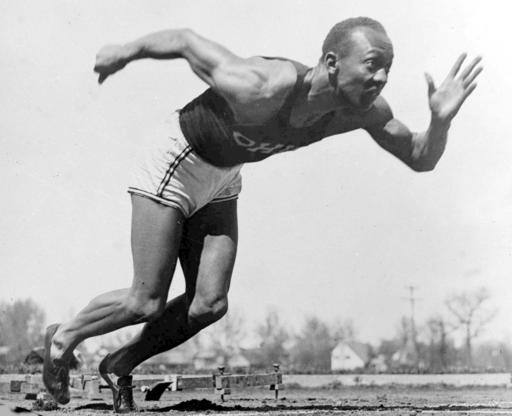 In this Aug. 5, 1936 file photo, American athlete Jesse Owens practices in the Olympic Village in Berlin. (AP Photo/File)