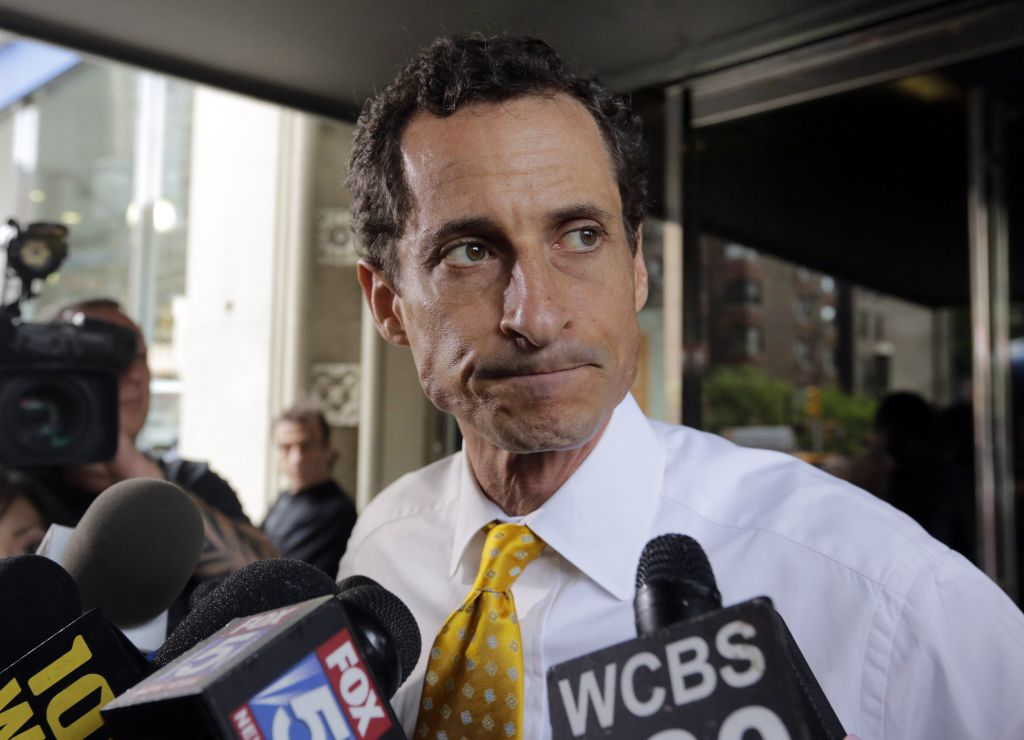 Disgraced former congressman Anthony Weiner leaves his New York apartment after acknowledging he texted sexually explicit messages with a girl online during his mayoral run (Richard Drew/AP)