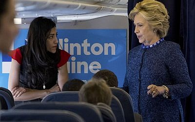 US Democratic presidential nominee Hillary Clinton (R) talks to her staff as aide Huma Abedin listens on board their campaign plane at the Westchester County Airport in White Plains, New York, before leaving for campaign rallies on October 28, 2016. (AFP PHOTO/Jewel SAMAD)