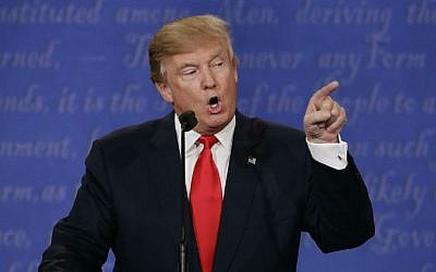 Republican presidential nominee Donald Trump speaks to Democratic presidential nominee Hillary Clinton during the third presidential debate at UNLV in Las Vegas, Wednesday, Oct. 19, 2016. (AP Photo/David Goldman)