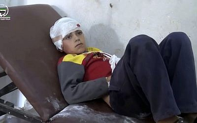 Frame grab from video provided by Muaz al-Shami, Syrian Revolution Network, an opposition activist media organization, shows a child on a hospital bed, with a bandage around his head after airstrikes killed over 20 people, in the northern rebel-held village of Hass, Syria, Wednesday, October 26, 2016. (Muaz al-Shami, Syrian Revolution Network, via AP)