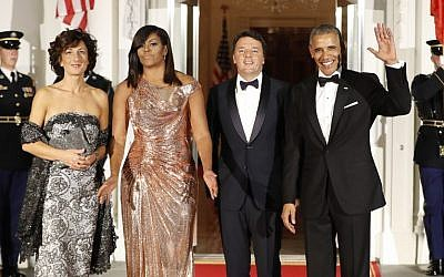 President Barack Obama and first lady Michelle Obama pose for a photo as they greet Italian Prime Minister Matteo Renzi and his wife Agnese Landini on the North Portico for a State Dinner at the White House in Washington, Tuesday, October 18, 2016. (AP Photo/Pablo Martinez Monsivais)