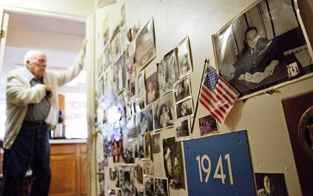 Memorabilia decorates a wall in the home of Frank Gleason, 96, rear, a retired colonel with the Office of Strategic Services, in Atlanta, Wednesday, Sept. 28, 2016. (AP/David Goldman)