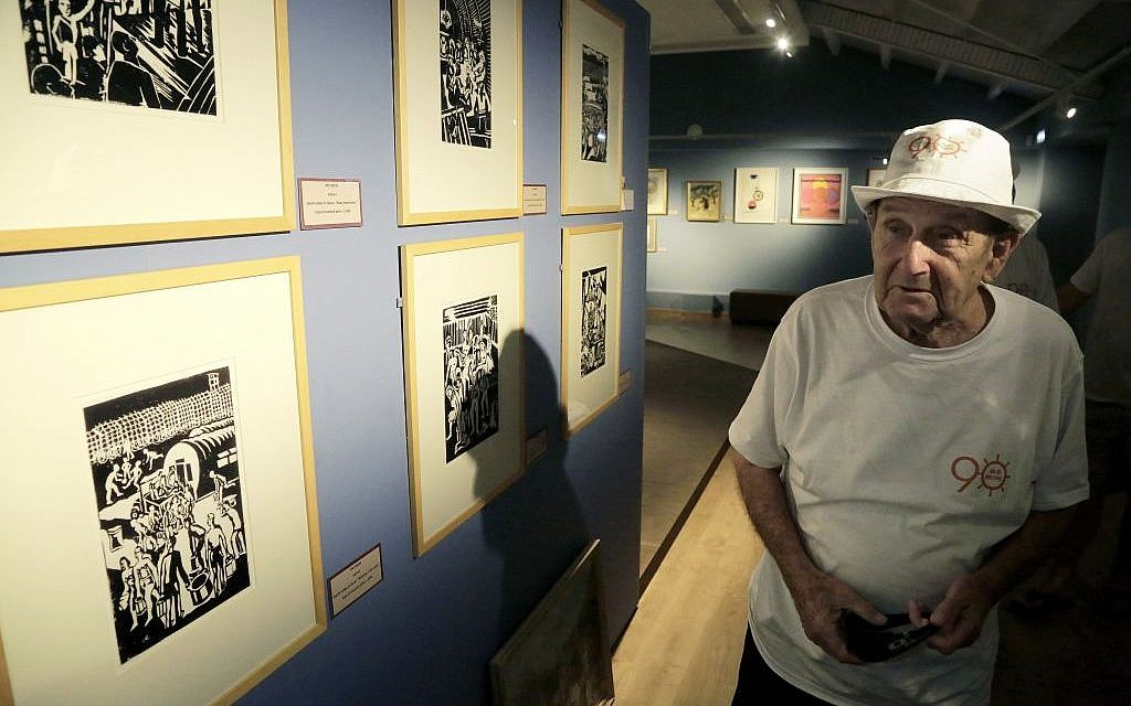 In this Thursday, Sept. 8, 2016 photo, Murray Greenfield, 90, walks around an exhibition about interned Jews at the Center of Visual Arts and Research in capital Nicosia, Cyprus.  (AP Photo/Petros Karadjias)