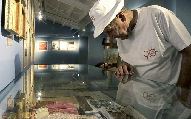 In this Thursday, Sept. 8, 2016 photo, Murray Greenfield, 90, looks around an exhibition about interned Jews at the Center of Visual Arts and Research in capital Nicosia, Cyprus. (AP Photo/Petros Karadjias)