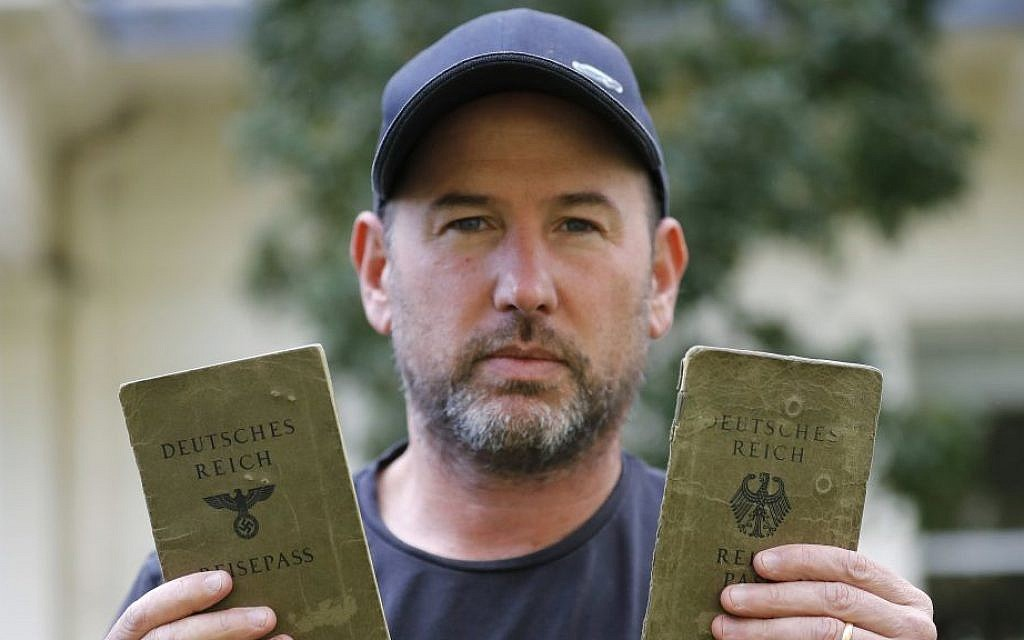 In this Wednesday, Oct. 5, 2016 photo, author Thomas Harding shows passports of his grandparents in London. Harding is doing what other descendants of Holocaust victims would find unimaginable: applying for a German passport. (AP Photo/Frank Augstein)