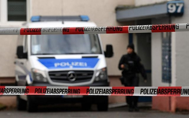 Police officers secure a cordoned off residential property in a housing estate in Chemnitz, eastern Germany, Sunday, Oct. 9, 2016, where police have been investigating a possible bomb plot.  (Hendrik Schmidt/dpa via AP)