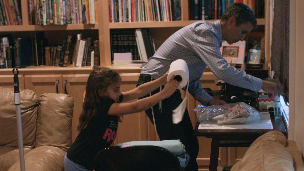 Brian Berman and his six-year-old daughter Nava Berman prepping for his infusion. (Courtesy Brian Berman)