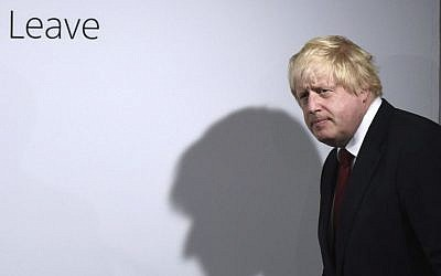 """In this Friday, June 24, 2016 file photo, Vote Leave campaigner Boris Johnson arrives for a press conference at Vote Leave headquarters in London . In the crucial days before Foreign Secretary Boris Johnson embraced Britain's """"leave campaign,"""" he wrote a newspaper column explaining why Britain should remain inside the European Union _ but those forceful words were never published before Britain's June 23 vote. The Sunday Times has now published Johnson's pro-EU column, which outlines his fears about leaving the EU on SUnday, Oct. 16, 2016. (Mary Turner/Pool via AP, File)"""