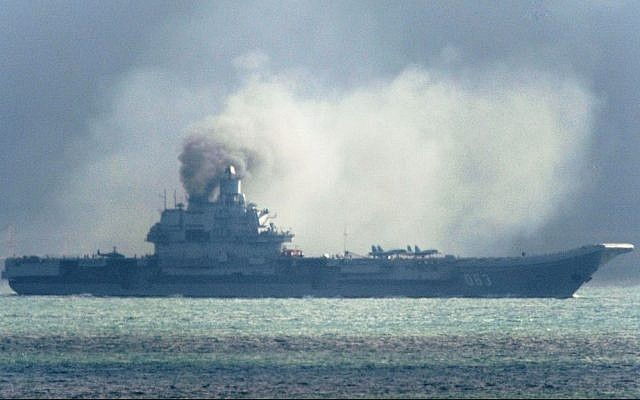 The Russian aircraft carrier Admiral Kuznetsov passes within a few miles of Dover, in the southeast of England as a fleet of Russian warships sail through the North Sea, and the English Channel Friday October 21, 2016, on their way to the eastern Mediterranean Sea (Gareth Fuller/PA Wire)