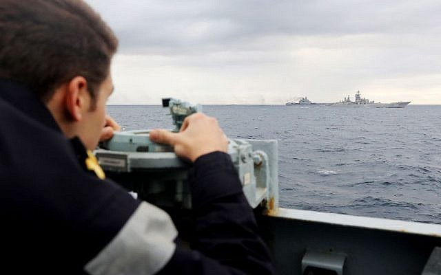 This  handout issued by Britain's Ministry of Defence and taken on Tuesday Oct 18, 2016 of a Royal Navy lookout onboard HMS Richmond, observing the  Russian  task group during its transit through the North Sea.  (PO(Phot) Dez Wade/MoD/Crown Copyright via AP)