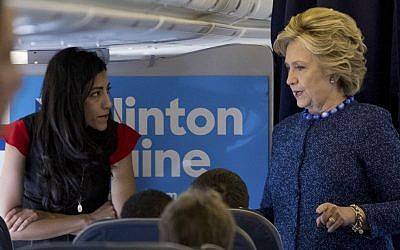 Then Democratic presidential candidate Hillary Clinton speaks with senior aide Huma Abedin aboard her campaign plane at Westchester County Airport, White Plains, October 28, 2016. (AP/Andrew Harnik)
