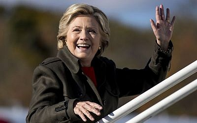 Democratic presidential candidate Hillary Clinton waves to members of the media as she boards her campaign plane at Westchester County Airport, White Plains, NY, October 31, 2016. (AP/Andrew Harnik)