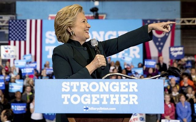 US Democratic presidential candidate Hillary Clinton points to the crowd while speaking at a rally at Cuyahoga Community College in Cleveland, Friday, Oct. 21, 2016. (AP Photo/Andrew Harnik)