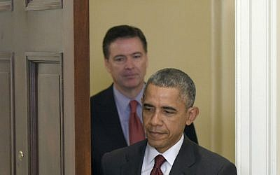 In this Nov. 25, 2015 file photo, President Barack Obama, followed by FBI Director James Comey, arrives in the Roosevelt Room of the White House in Washington to brief the public on the nation's homeland security posture heading into the holiday season, following a meeting with his national security team. (AP Photo/Susan Walsh, File)