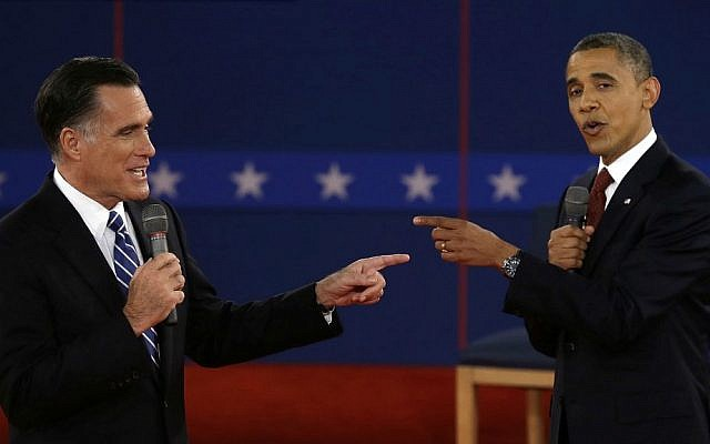 In this Oct. 16, 2012 file photo, Republican presidential nominee Mitt Romney, left, and President Barack Obama spar during the second presidential debate at Hofstra University in Hempstead, New York. (AP Photo/Charlie Neibergall, File)