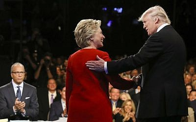 Democratic presidential nominee Hillary Clinton and Republican rival Donald Trump shake hands during the first presidential debate at Hofstra University in Hempstead, New York on Sept. 26, 2016. (Joe Raedle/Pool via AP, File)