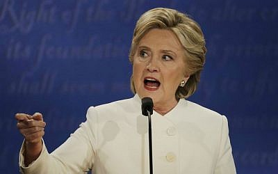 Democratic presidential nominee Hillary Clinton speaks to Republican presidential nominee Donald Trump during the third presidential debate at UNLV in Las Vegas, Wednesday, Oct. 19, 2016. (AP Photo/Patrick Semansky)