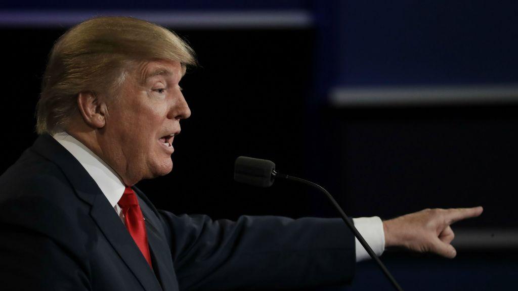 Republican presidential nominee Donald Trump points to Democratic presidential nominee Hillary Clinton during the third presidential debate at UNLV in Las Vegas, Wednesday, Oct. 19, 2016. (AP Photo/Patrick Semansky)