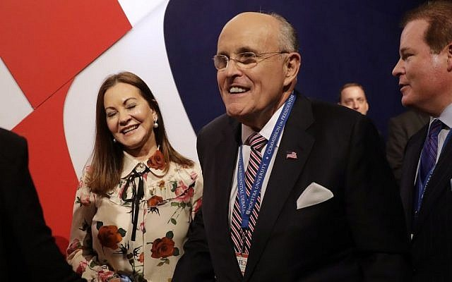 Former mayor of New York CIty Rudy Giuliani arrives with his wife Judith for the presidential debate between Democratic presidential nominee Hillary Clinton and Republican presidential nominee Donald Trump at Hofstra University in Hempstead, N.Y., Monday, Sept. 26, 2016. (AP/Patrick Semansky)