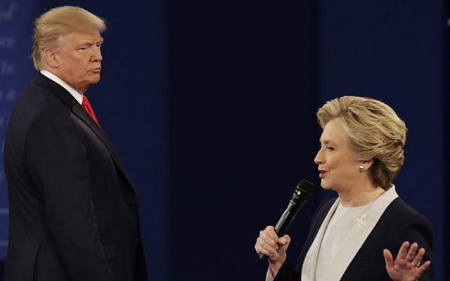 Republican presidential nominee Donald Trump, left, listens to Democratic presidential nominee Hillary Clinton during the second presidential debate at Washington University in St. Louis, October 9, 2016. (AP/Patrick Semansky)