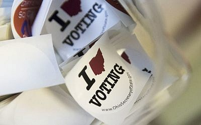 In this Oct. 12, 2016 photo, stickers available for voters are seen at the Hamilton County Board of Elections in Cincinnati, Ohio, as early voting begins statewide. (AP/John Minchillo)