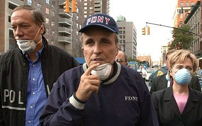 In this Wednesday, Sept. 12, 2001 file photo, then-New York City mayor Rudolph Giuliani, center, leads New York governor George Pataki, left, and senator Hillary Clinton, D-New York, on a tour of the site of the World Trade Center attack. (AP Photo/Robert F. Bukaty, File)