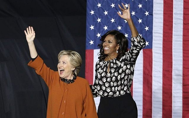 Democratic presidential candidate Hillary Clinton and first lady Michelle Obama wave to supporters during a campaign rally in Winston-Salem, North Carolina, Thursday, Oct. 27, 2016. (AP/Chuck Burton)