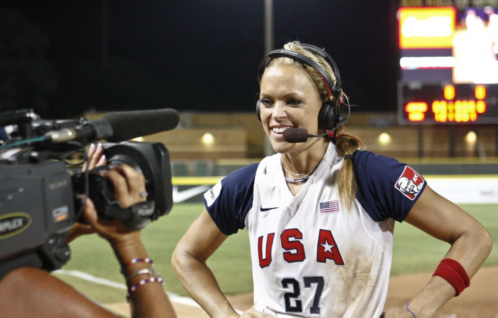"""In this Monday, July 26, 2010 file photo, USA's Jennie Finch talks with the media following the World Cup of Softball Championship game against Japan in Oklahoma City. A former contestant on the reality television show """"The Apprentice,"""" Finch says the show's star, Donald Trump, """"was extremely supportive. You could tell there was so much respect there on all sides, especially with the female athletes. … Obviously, he was complimentary, but never in an inappropriate way."""" (AP Photo/Alonzo Adams)"""