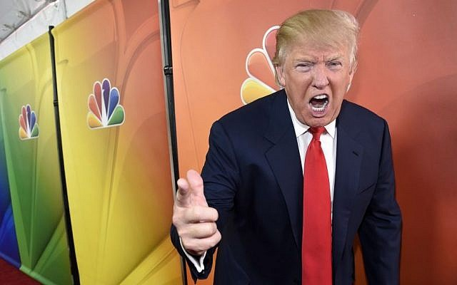 Donald Trump, then-host of the reality television series 'The Celebrity Apprentice,' poses for photographers, January 16, 2015. (Chris Pizzello/Invision/AP)