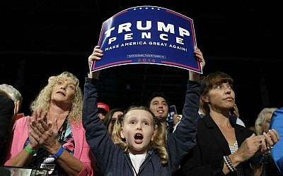 People cheer as Republican presidential candidate Donald Trump speaks at a rally, Friday, Sept. 30, 2016, in Novi, Michigan. (AP Photo/John Locher)