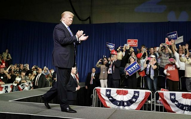 Republican presidential candidate Donald Trump takes the stage at a rally, Friday, Sept. 30, 2016, in Novi, Michigan. (AP Photo/John Locher)