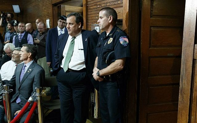 Gov. Chris Christie, R-New Jersey, waits for the arrival of Republican presidential candidate Donald Trump to a town hall, Thursday, Oct. 6, 2016, in Sandown, New Hampshire. (AP Photo/Evan Vucci)